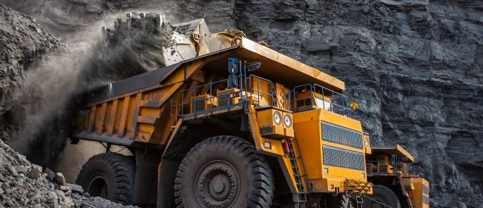 Mining truck loading materials at a mine