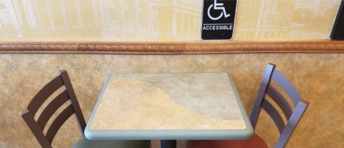 Accessibility sign above a restaurant table
