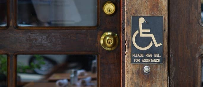 Disability sign at restaurant entrance