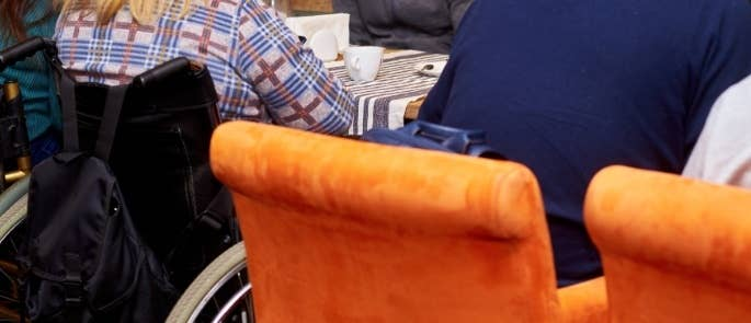 Person with wheelchair in a cafe