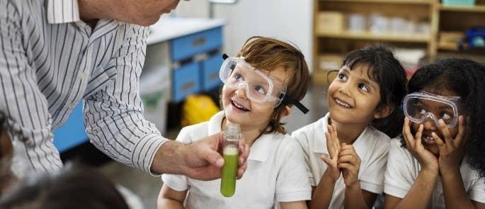Three primary school children in a science lesson