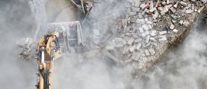 Silica dust cloud forming as a building is being demolished.