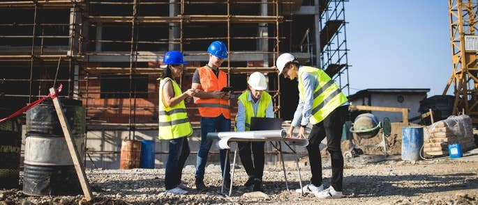 Construction workers gathering to assess risks