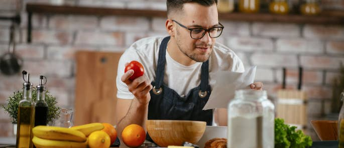 Man looking for a recipe to use so he can begin cooking