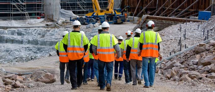 A group of construction workers heading to the construction site