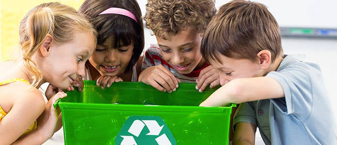 School children working together to recycle