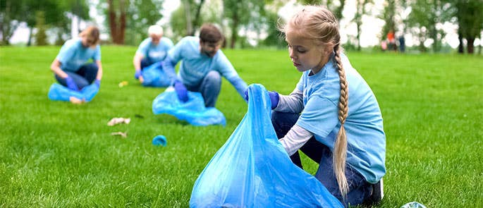 School volunteers helping to pick up waste