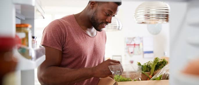 A man unpacking his online food delivery