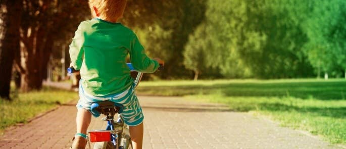 Boy riding bike outdoors