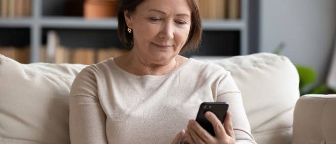 Woman checking phone messages