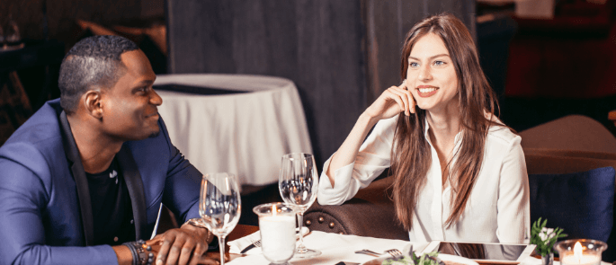 Couple enjoying a meal in a restaurant together