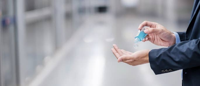 Man using hand sanitiser