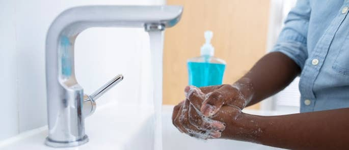 Boy washing his hands at home