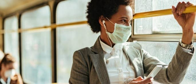 Woman travelling on train wearing face mask