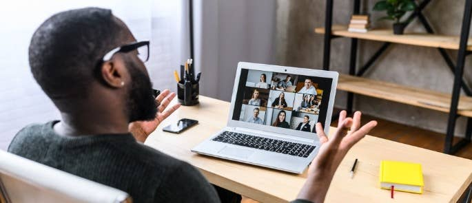 Worker having a virtual meeting over video call
