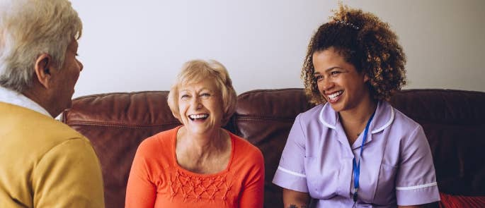 Carer enjoying a home visit with two patients