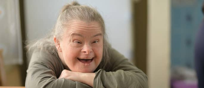 Woman with Down's Syndrome smiling