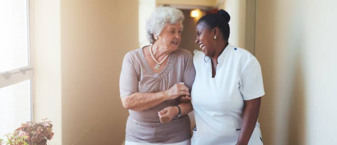 Carer and lady walking and laughing