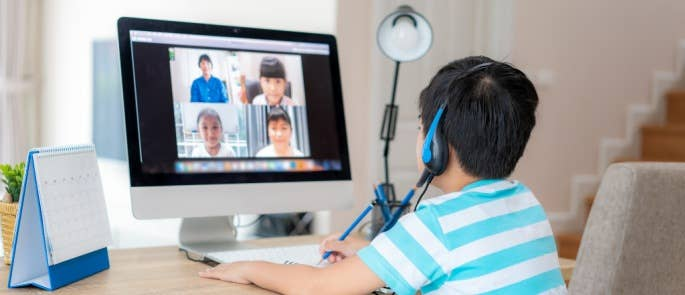 Boy chatting to classmates in a virtual classroom