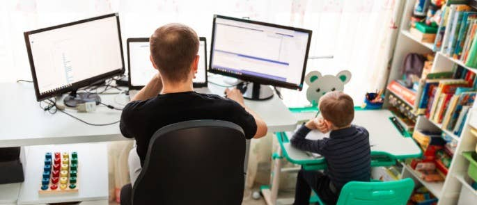 Father and son working together at home