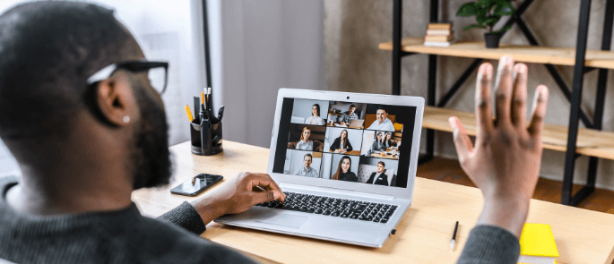 A remote worker involved in a group video call online