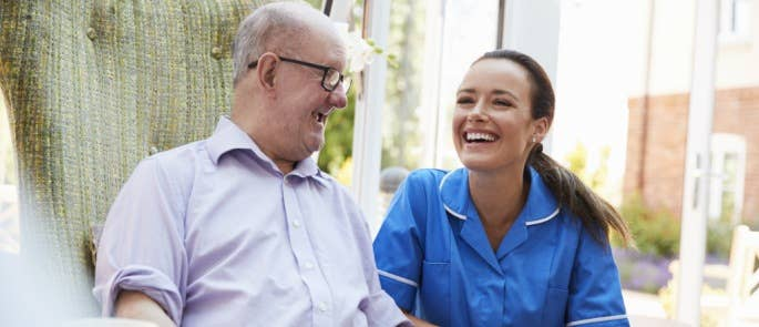 Carer and service user laughing