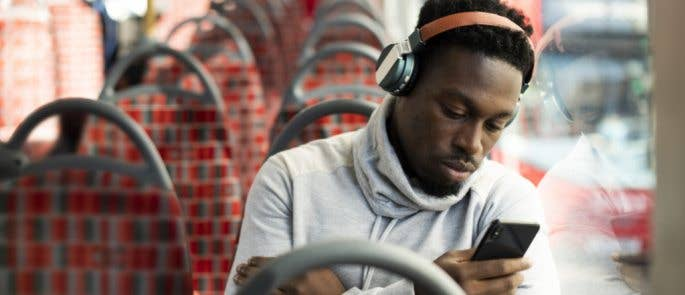 Man completing e-learning while on a bus