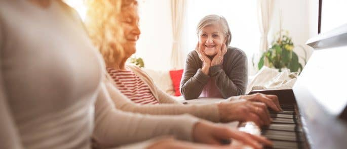 Music therapy session at the piano with elderly client
