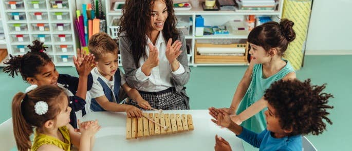 Group music therapy session with young children