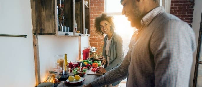Couple preparing plant based meal