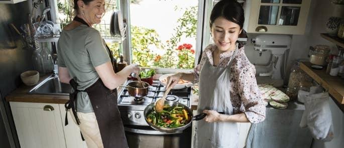 Women cooking vegetables