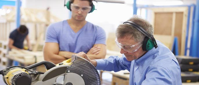 Two men at a college construction skills training session