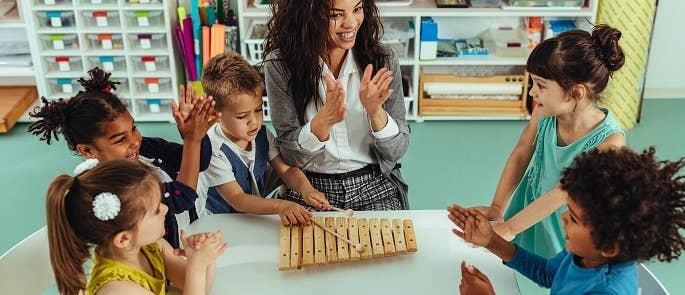 Nursery teacher instructing her class