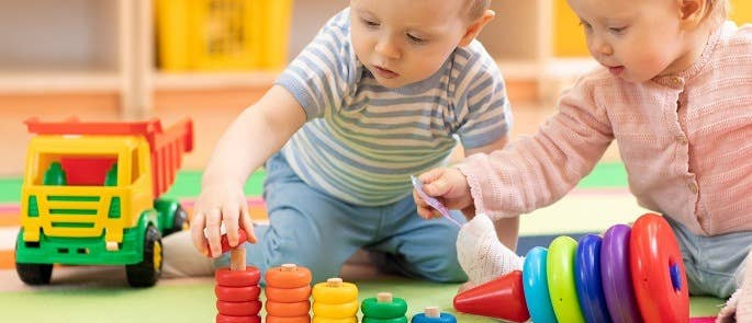 Two children playing in nursery