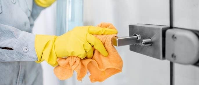 Cleaner wiping door handle with cloth
