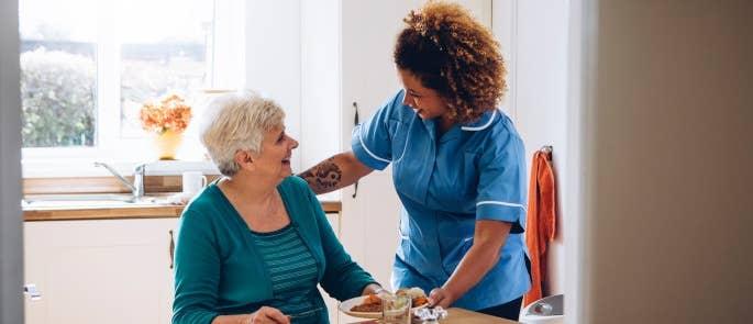 Nurse providing domiciliary care in a lady's home
