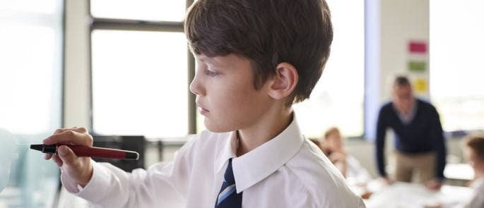 Child learning in the classroom