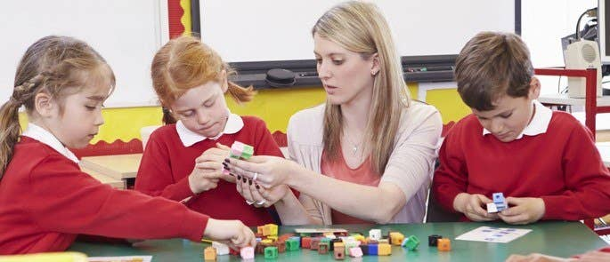 Teacher supporting students in the classroom