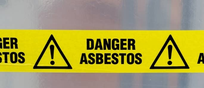 Asbestos tape sign on construction site