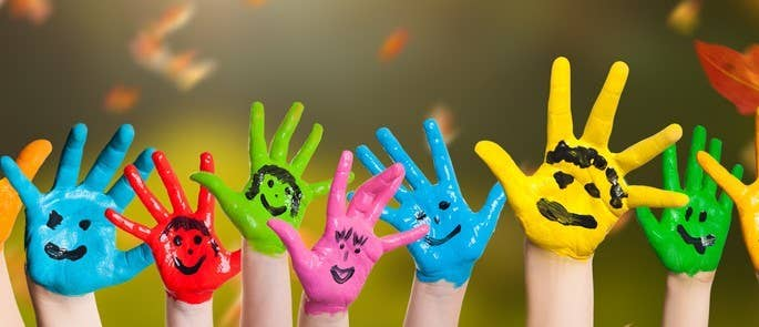 Children with colourfully painted hands