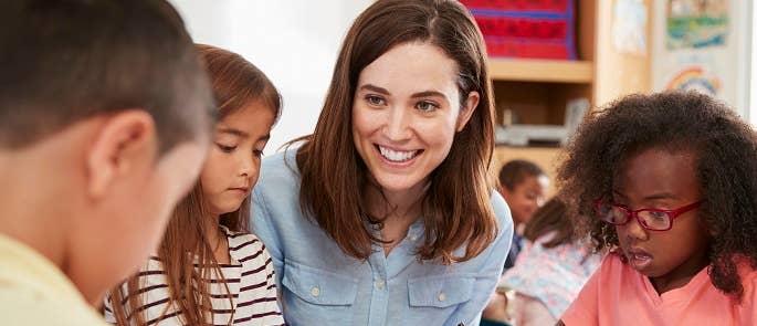 Teacher talking to pupils