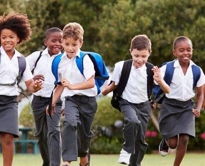 children running and enjoying school