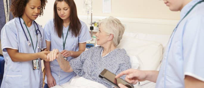 Health and social care workers talking to a service user