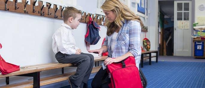 Teacher talking to a child